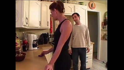 Brunette mom works great in the kitchen on the sofa