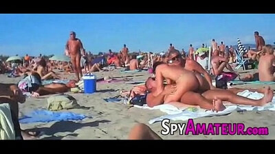 Candid voyeur with nice shoeplay in pool to beach group