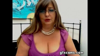 chubby mature strips in front of the webcam