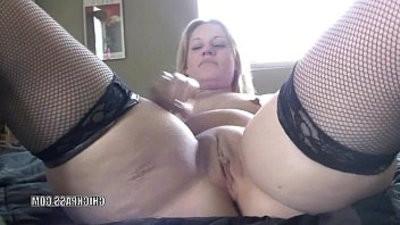 Raunchy mummy Lisa fucks her wet twat with a huge dildo
