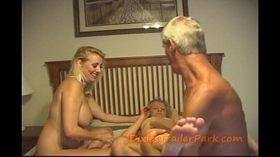 Swinger milf fucking in his face and mouth in group orgy