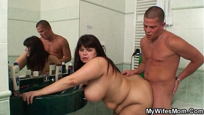 Chubby mom goes to the bathroom and satisfies her girl