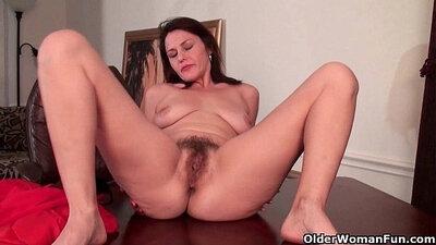 Classy mature finger fucks her hairy pussy