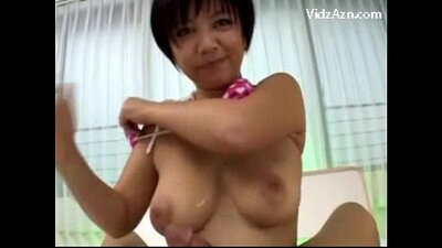 Busty MILF rubbing a cock on lingerie