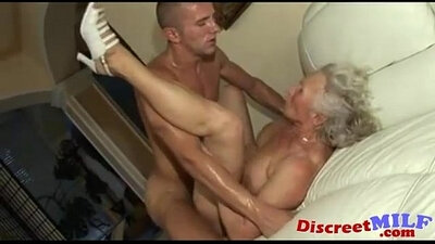 Hairy granny gives objects to her tight pussy