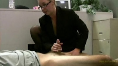 Employee gets masturbated by his horny mature lady boss