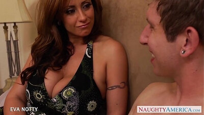 Big tattooed milf grinds on a hard cock of a young guy
