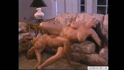 Blonde and brunette lesbians fuck in the garden