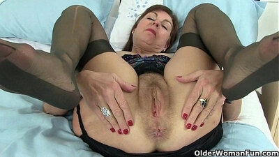 British granny playing with poo using a dildo