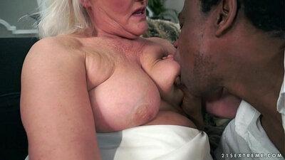 Black granny tugging against a hard cock