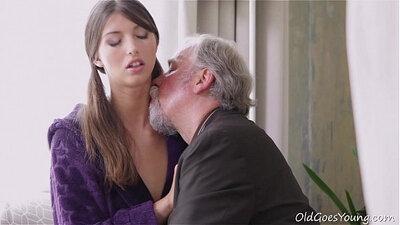 Big old man kisses young girl