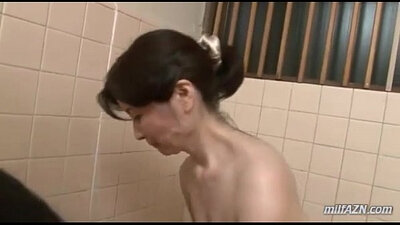 Big titted mature sucks young cock